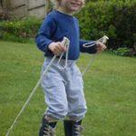 Lucas skiing on grass